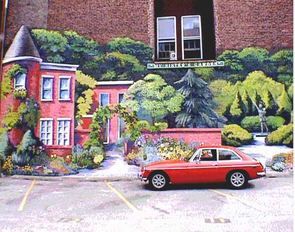 Obie in front of 'My Sisters Garden Mural, downtown Baltimore MD